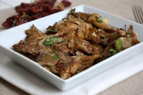 Ricette Contorni Funghi pleurotus al forno