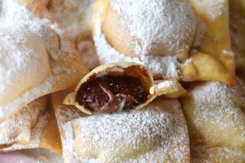 Ricette Dolci di Carnevale Bugie ripiene di Nutella